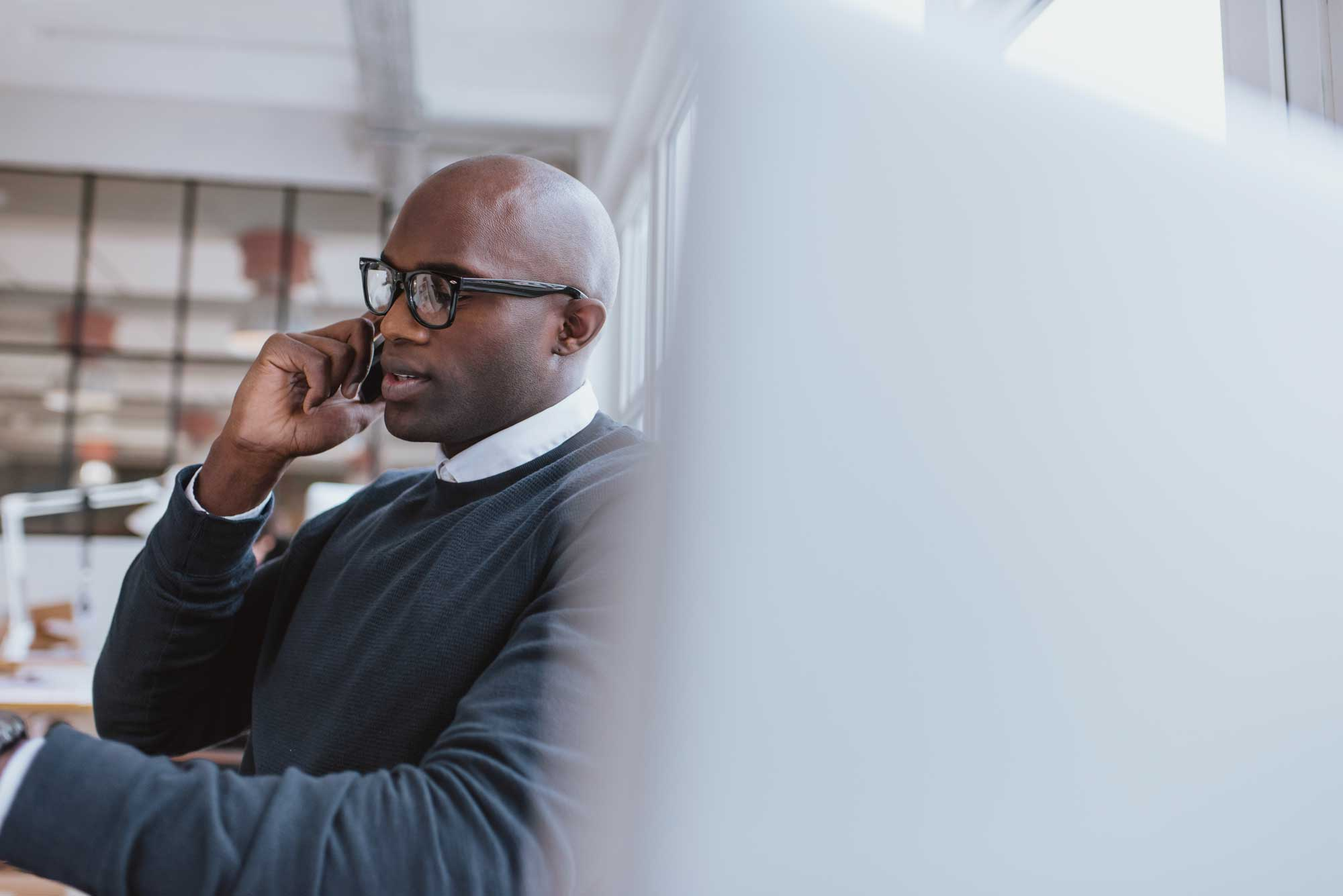 Man on phone - Engage a Global PEO
